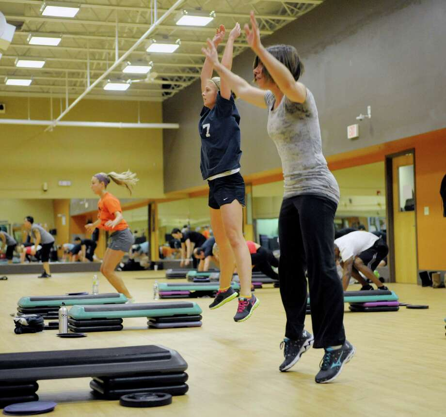 Ali Bullis, left, Caitlyn Parry, center, and Danielle Pesta, right, take part in a high intensity interval training class at Best Fitness Albany on Monday, Jan. 6, 2014 in Albany, NY.   (Paul Buckowski / Times Union) Photo: Paul Buckowski / 00025232A