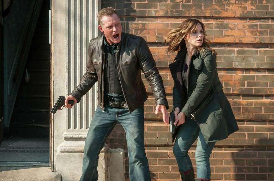 "CHICAGO P.D. -- ""Stepping Stone"" Episode 101 -- Pictured: (l-r) Jason Beghe as Hank Voight, Sophia Bush as Erin Lindsay -- (Photo by: Matt Dinerstein/NBC) ORG XMIT: Season: 1 Photo: NBC / 2013 NBCUniversal Media, LLC"