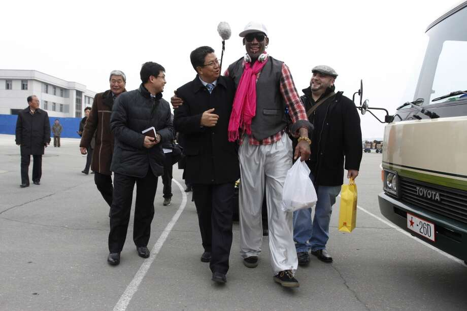 Former NBA basketball star Dennis Rodman, second right, walks with North Korea's Sports Ministry Vice Minister Son Kwang Ho, third right, upon his arrival at the international airport in Pyongyang, North Korea, Monday, Jan. 6, 2014. Rodman took a team of former NBA players on a trip for an exhibition game on Kim Jong Un's birthday, Wednesday, Jan. 8. Photo: Kim Kwang Hyon, Associated Press