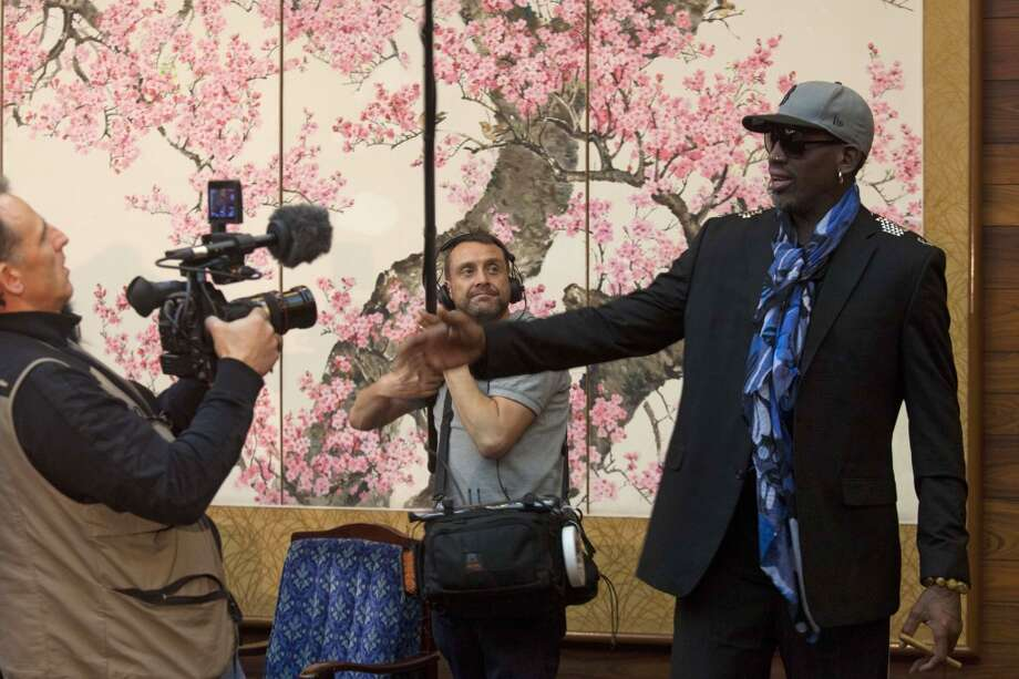 Dennis Rodman is filmed by a documentary film crew at a Pyongyang, North Korea hotel Tuesday, Jan. 7, 2014. Rodman came to the North Korean capital with a team of USA basketball stars for an exhibition game on Jan. 8, the birthday of North Korean leader Kim Jong Un. Photo: David Guttenfelder, Associated Press