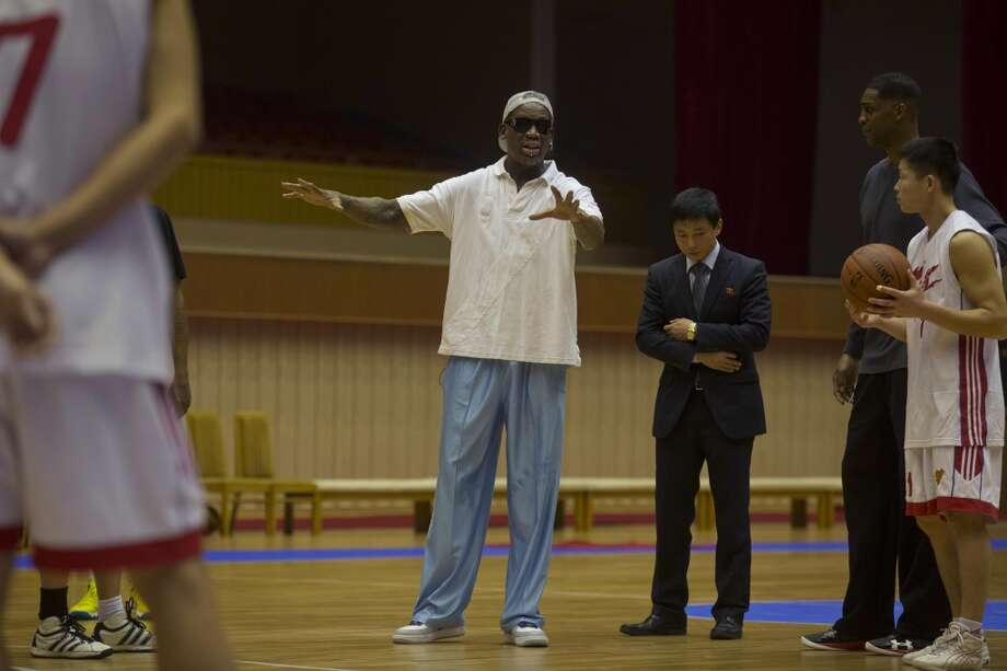 Dennis Rodman coaches from court side as North Korean and US basketball players practice in Pyongyang, North Korea on Tuesday, Jan. 7, 2014. Rodman came the North Korean capital with a squad of USA basketball stars for an exhibition game on Jan. 8, the birthday of North Korean leader Kim Jong Un. On the far right is former NBA basketball star Charles D. Smith. Photo: Kim Kwang Hyon, Associated Press