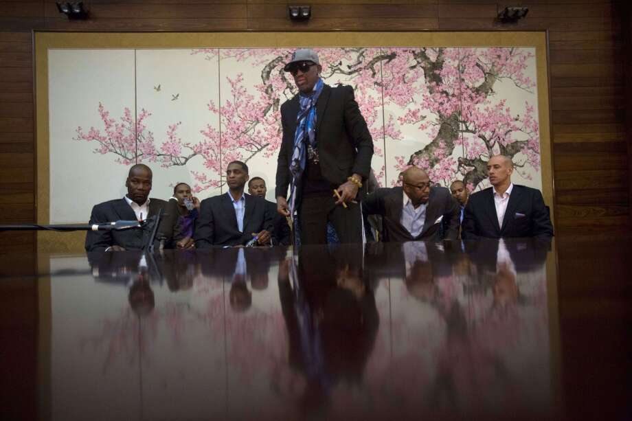 "Dennis Rodman stands up to leave after he and fellow US basketball players completed a television interview at a Pyongyang, North Korea hotel Tuesday, Jan. 7, 2014. Rodman came to the North Korean capital with a team of USA basketball stars for an exhibition game on Jan. 8, the birthday of North Korean leader Kim Jong Un. From left to right are Cliff Robinson, Jerry Dupree, Charles D. Smith, unidentified, Vin Baker, Andre ""Silk"" Poole and Doug Christie. Photo: David Guttenfelder, Associated Press"