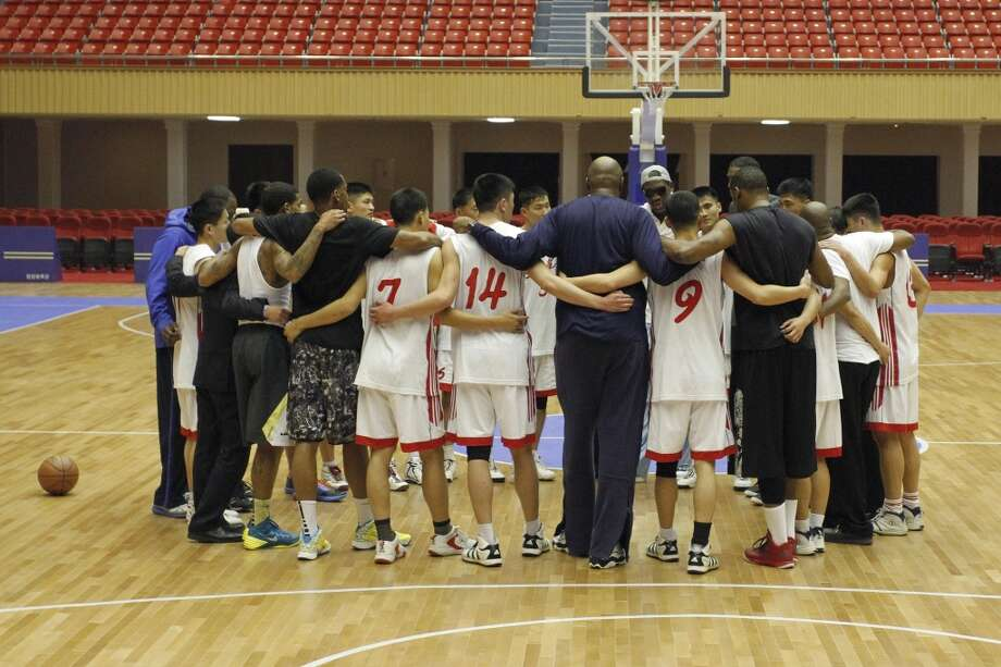 Dennis Rodman huddles with North Korean basketball players and fellow former NBA stars at a practice session in Pyongyang, North Korea on Tuesday, Jan. 7, 2014. Rodman came to the North Korean capital with a squad of U.S. basketball stars for an exhibition game on Jan. 8, the birthday of North Korean leader Kim Jong Un. Photo: Kim Kwang Hyon, Associated Press