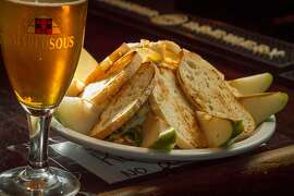 The Stilton, Pear and Walnut Platter with a beer at Rose and Crown Pub in Palo Alto, Calif., is seen on January 3rd, 2014.