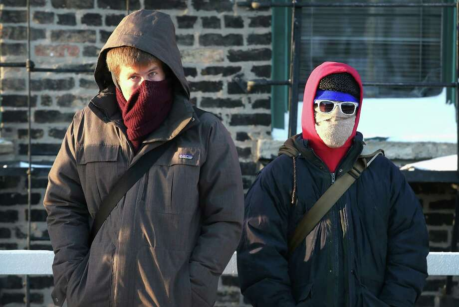 In NYC, the fashion police will cite you for wearing North Face, so use this handy guide when heading out into the Polar Vortex. Photo: Scott Olson, Getty Images / 2014 Getty Images