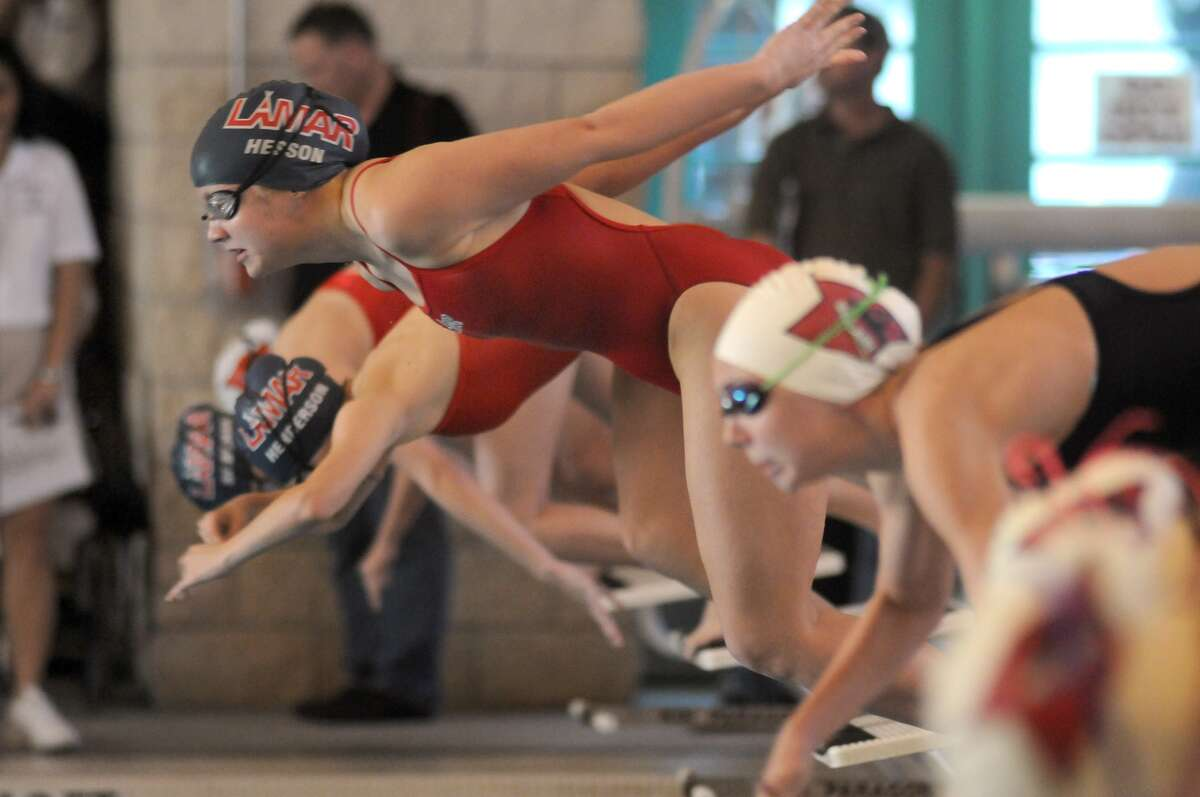 Lamar High School's Thea Hesson, center, leaves the blocks in her heat of the Girls 200 Yard Individual Medley during the 2013 District 20-5A Swimming and Diving Championships at Lamar High School. Freelance photo by Jerry Baker