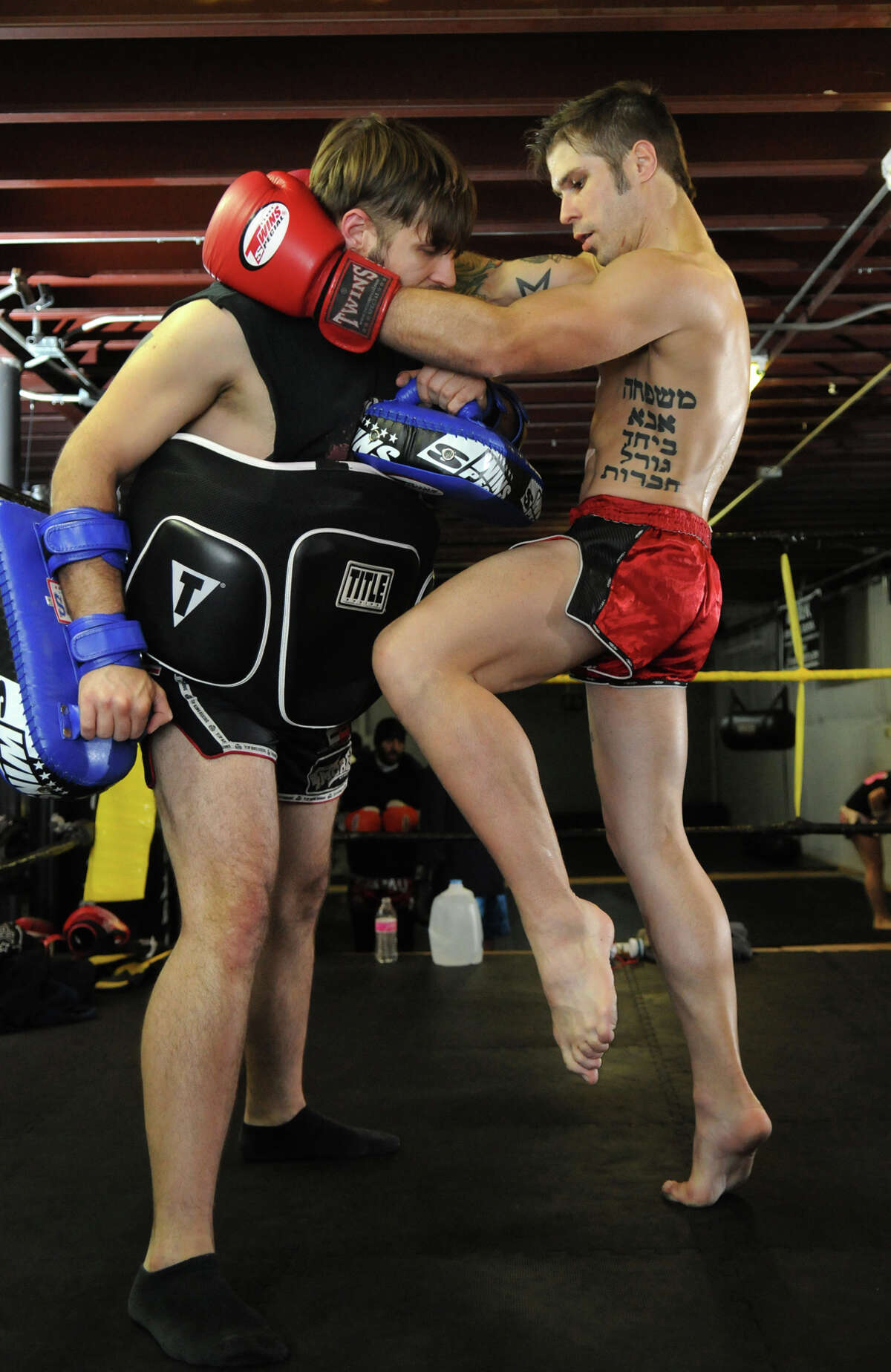 Sam Mongonia, 27, from right, spars with his brother, Nate, 28, during a training session at Revolution Dojo.