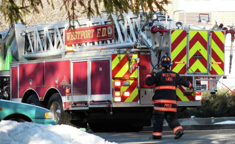 Firefighters were dispatched to the Saugatuck, a housing complex for senior citizens on Bridge Street, Tuesday afternoon after the odor of gas was detected. Photo: Anne M. Amato / Westport News