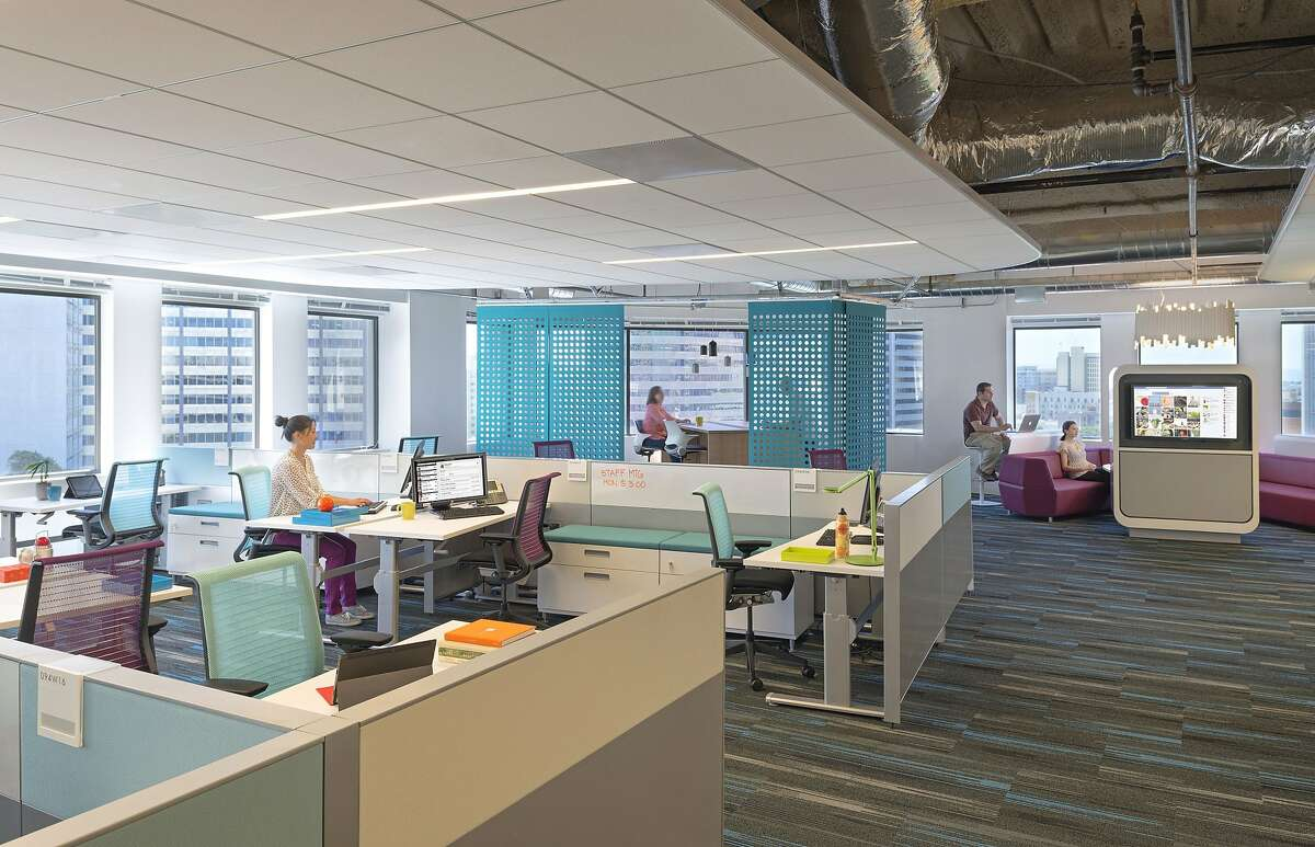 At Kaiser Permanente, the office is redesigned and some of the area is set aside for unassigned seating.
