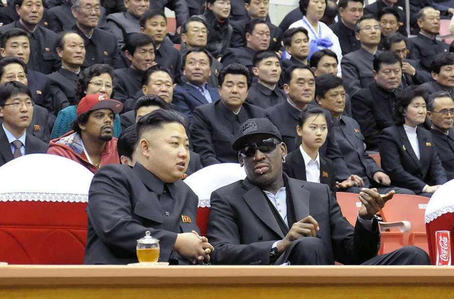 This photo taken on February 28, 2013 and released by North Korea's official Korean Central News Agency (KCNA) on March 1, 2013 shows North Korean leader Kim Jong-Un (front L) and former NBA star Dennis Rodman (front R) speaking at a basketball game in Pyongyang. Flamboyant former NBA star Dennis Rodman has become the most high-profile American to meet the new leader of North Korea, vowing eternal friendship with Kim Jong-Un at a basketball game in Pyongyang. Photo: KCNA, AFP/Getty Images