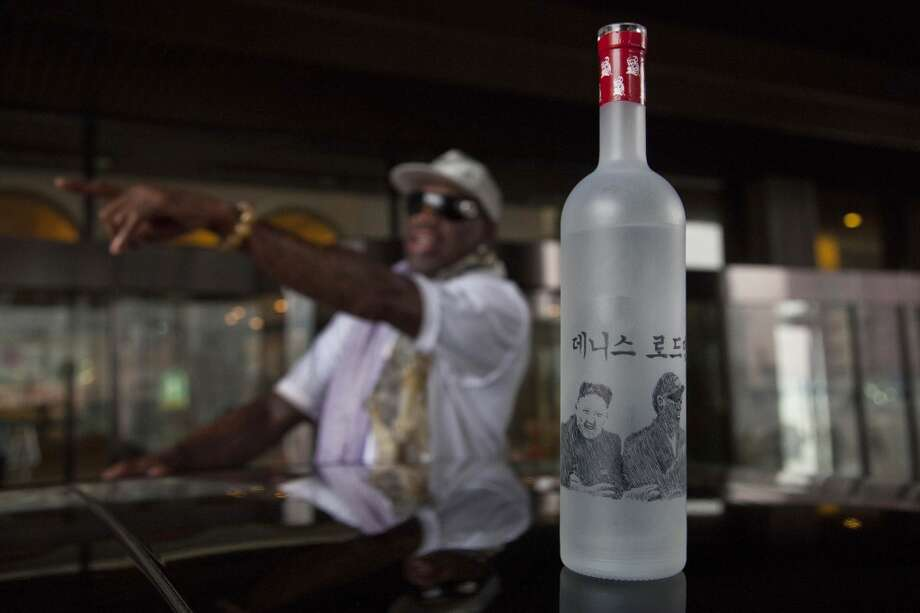 A bottle of vodka with handmade illustrations of Rodman with North Korean leader Kim Jong Un and Rodman's name in Korean sits on the roof of a car outside a Pyongyang hotel on Tuesday, Jan. 7, 2014. Rodman came to the North Korean capital with a team of USA basketball stars for an exhibition game on Jan. 8, the birthday of North Korean leader Kim Jong Un. Photo: David Guttenfelder, Associated Press