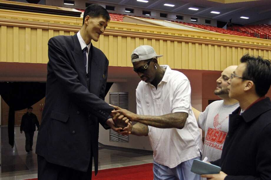 Dennis Rodman, center,  meets with former North Korean basketball player Ri Myung Hun at a practice session with USA and North Korean players in Pyongyang, North Korea on Tuesday, Jan. 7, 2014. Rodman came to the North Korean capital with a squad of USA basketball stars for an exhibition game on Jan. 8, the birthday of North Korean leader Kim Jong Un. Photo: Kim Kwang Hyon, Associated Press