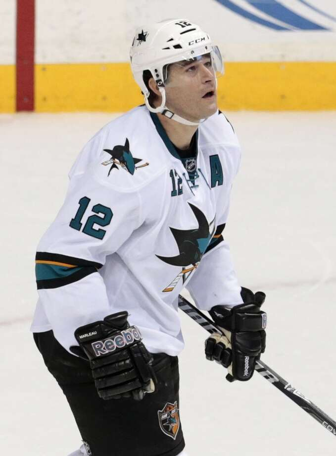San Jose Sharks center Patrick Marleau skates to the bench after scoring against the Nashville Predators in the third period of an NHL hockey game on Saturday, Dec. 14, 2013. Photo: Mark Humphrey, Associated Press