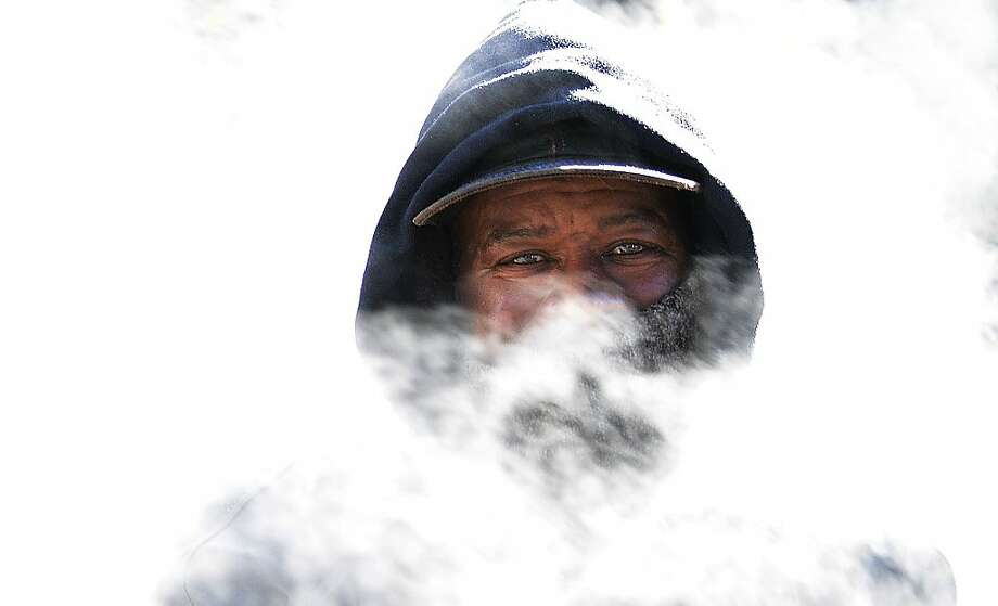 A homeless man braves the Washington, D.C., cold. All 50 states saw freezing temperatures Tuesday. Photo: Olivier Douliery, McClatchy-Tribune News Service