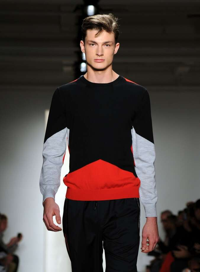 Resolution: Clean up your look with minimalism and color-blocking. Keep the silhouette strict and simple (reference classic Jil Sander when in doubt) and give your look a pop with some artful color-blocking (Tim Coppens, Spring 2014 look shown.) If it was good enough for Mondrian, it's good enough for spring. Photo: Ilya S. Savenok, Getty Images