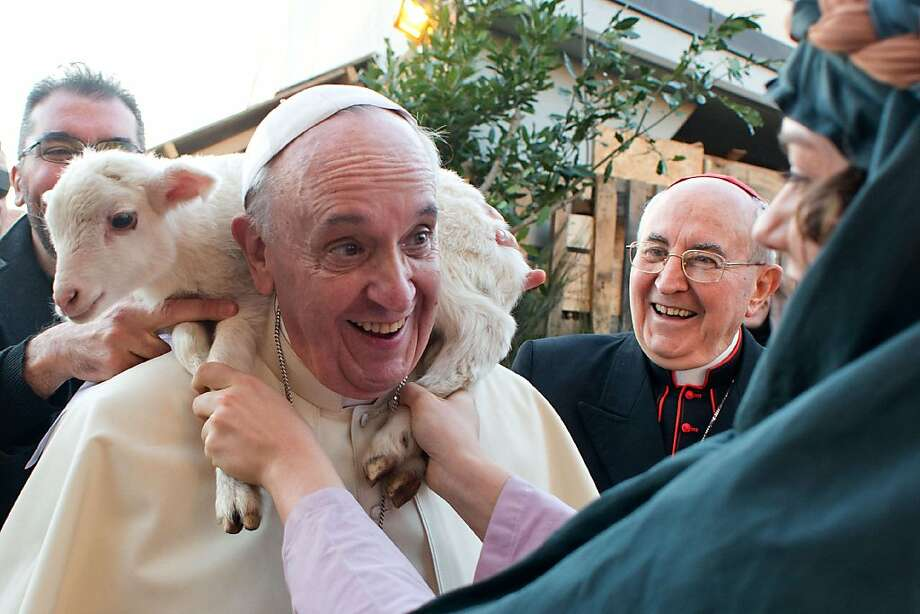 Wool scarf, Your Holiness? Pope Francis is greeted with a cute little neck warmer at the parish of Sant'Alfonso Maria de Liguori during Epiphany day in Rome. Photo: Osservatore Romano, AFP/Getty Images