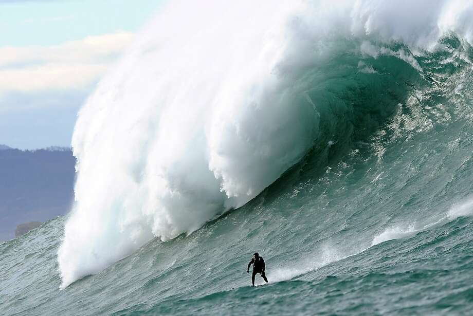 A brave soul surfs a giant Belharra wave about two kilometers off the coast of the French Basque town of Urrugne. During 