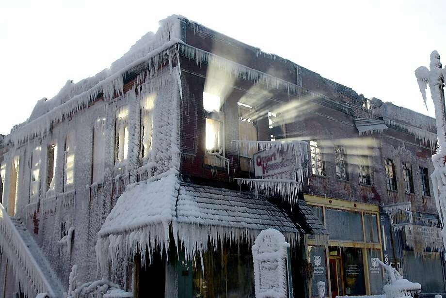 Sunlight streams through the windows of burned building in Plattsmouth, Neb. The icicles formed while firefighters were hosing down the blaze. Photo: Nati Harnik, Associated Press