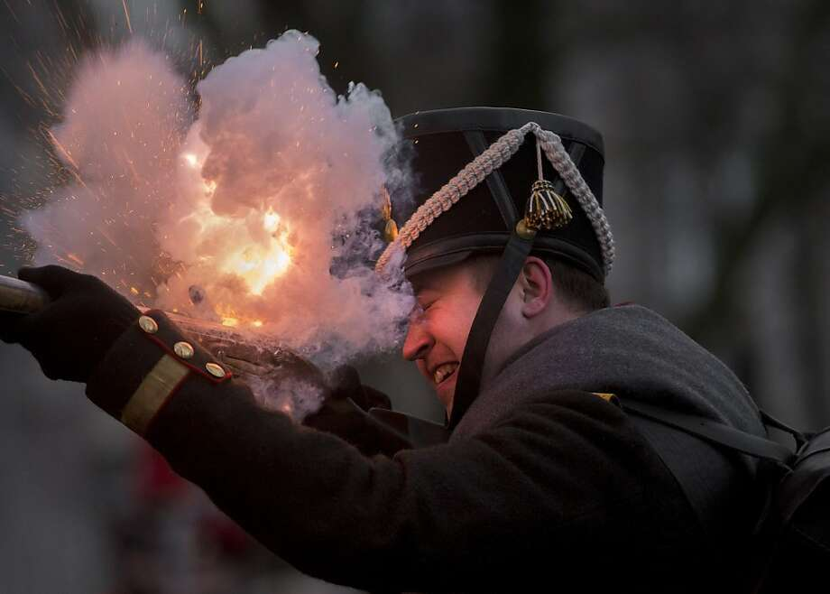 Too much powder? An 1812-era Russian army re-enactor fires his musket during a historic festival marking the Russian Orthodox Christmas in St. Petersburg. Photo: Dmitry Lovetsky, Associated Press