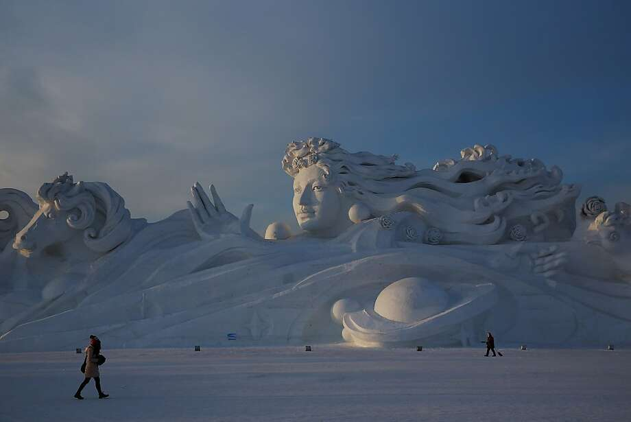 Goddess of snow: While Americans plow, shovel and generally complain about snow, the Chinese build beautiful statues out of it in Harbin. This monumental work at the Harbin International Snow Sculpture Art Expo is 117 meters long and 26 meters high. Photo: Lintao Zhang, Getty Images