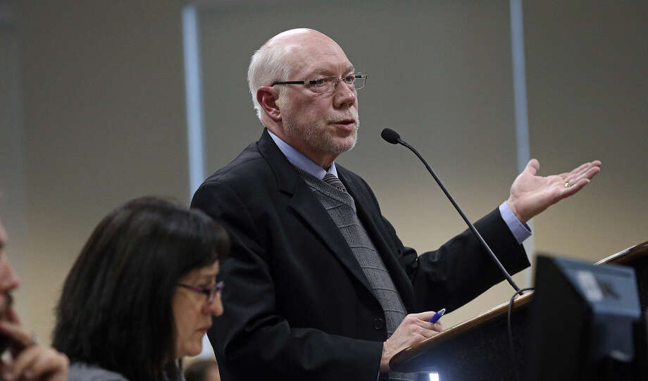 John Dugan, director of the city of San Antonio's Department of Planning & Community Development, hears public comments regarding the annexation of a large portion of land on the South Side during a recent meeting. Photo: Tom Reel / San Antonio Express-News