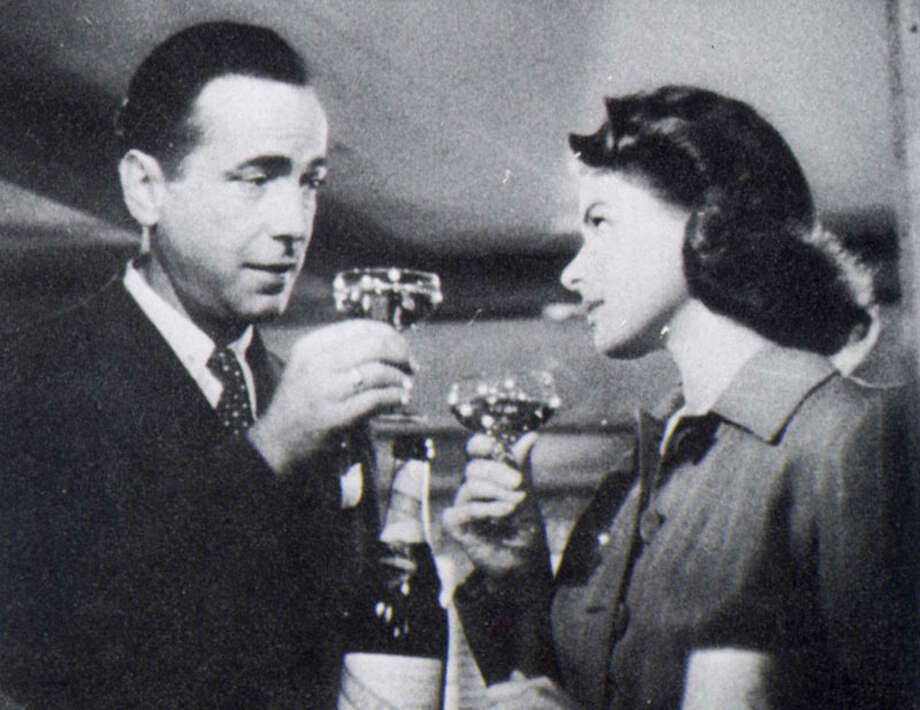 """""""Casablanca""""Champagne  The champagne flows for Humphrey Bogart and Ingrid Bergman in the movie classic """"Casablanca."""" Photo: Picasa / handout book scan"""