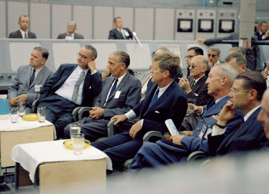 President John F. Kennedy  and vice president Lyndon B. Johnson  listen to a presentation during a tour of Cape Canaveral, Fla., Sept. 11, 1962. Among those pictured are, front row, NASA administrator James Webb, LBJ, German-born rocket scientist and NASA launch operations director Kurt Debus , JFK, unidentified, and US Secretary of Defense Robert McNamara . Photo: Interim Archives, Getty Images