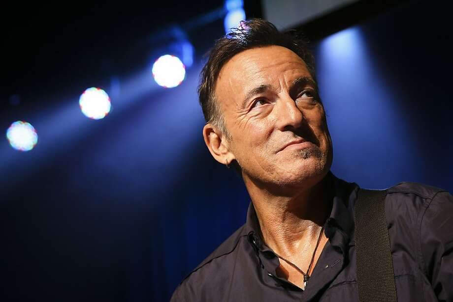 "FILE - This Nov. 7, 2013 file photo shows musician Bruce Springsteen stands on stage at the Stand Up for Heroes event at Madison Square Garden in New York. A handwritten working manuscript of Bruce Springsteen's 1975 hit ""Born to Run"" will be offered at auction on Dec. 5 in New York. Sotheby's said Wednesday, Nov. 27, the presale estimate is $70,000 to $100,000. (John Minchillo/Invision/AP, File) Photo: John Minchillo, Associated Press"