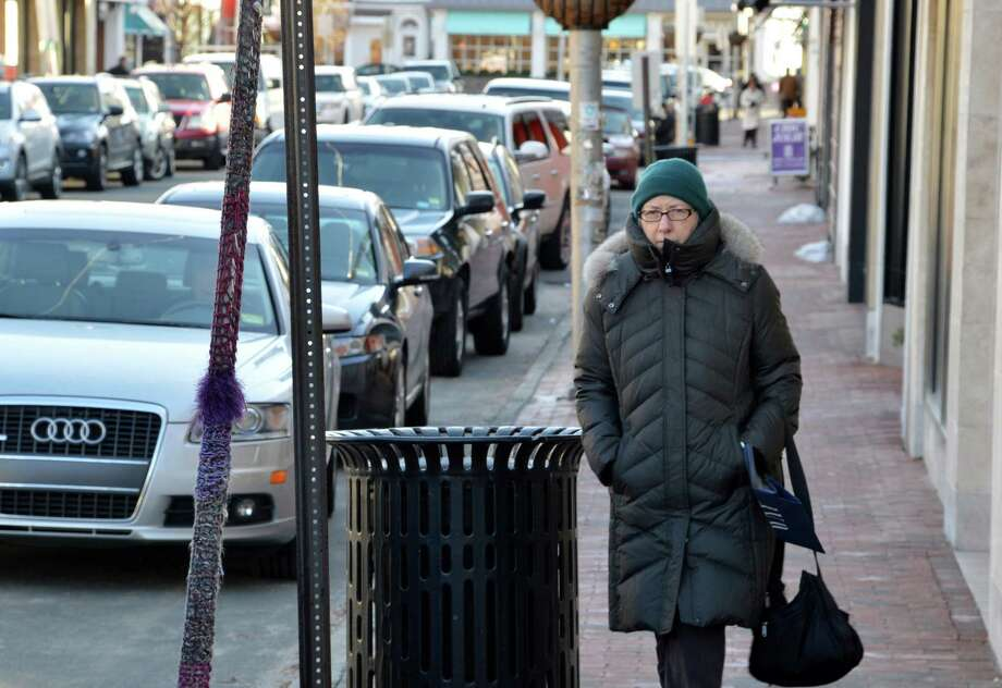 """It's such clear beautiful air,"" said Joanne Kabak, bundled against the frigid temperatures as she walked on Main Street Tuesday. ""I like that part of it. I wish it wasn't so bone-chilling."" Photo: Jarret Liotta / Westport News contributed"
