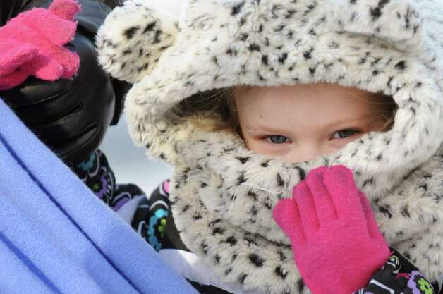 Breanna Moseley, 2, of Ballston Spa fights the frigid air as she walks with her grandmother Reisha Murray, visiting from Magnolia, Texas, on Tuesday, Jan. 7, 2014, in Ballston Spa, N.Y. (Cindy Schultz / Times Union) Photo: Cindy Schultz / 00025268A