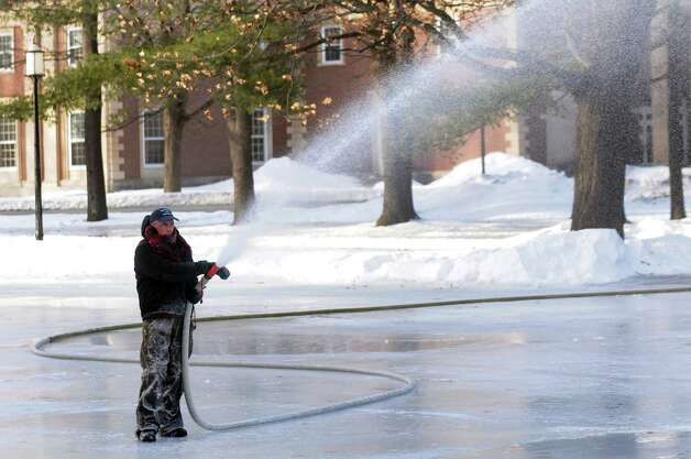 Maintenance worker Dan Urkevich sprays a fresh coat of water on the ice skating rink on Tuesday, Jan. 7, 2014, at Saratoga Spa State Park in Saratoga Springs, N.Y. (Cindy Schultz / Times Union) Photo: Cindy Schultz / 00025268A