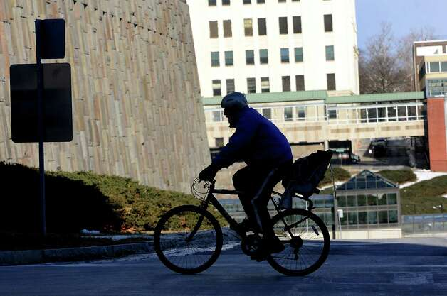 A bicyclist rides up Madison Ave. on a brutally cold day on Tuesday, Jan. 7, 2014 in Albany, N.Y. (Lori Van Buren / Times Union) Photo: Lori Van Buren / 00025268A