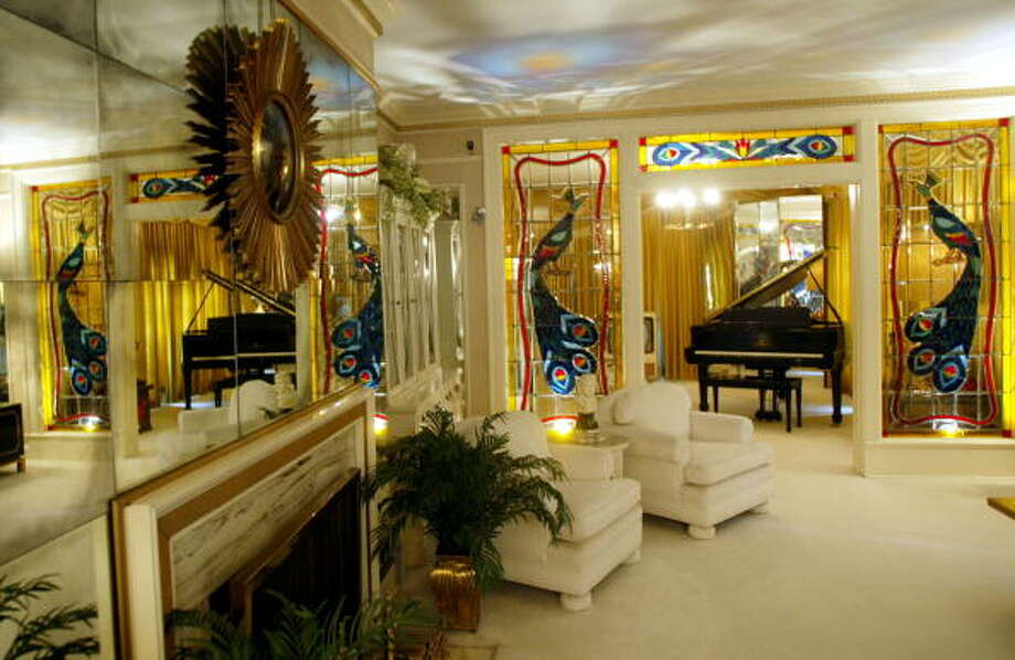 Elvis Presley's living room at Graceland is seen during Elvis Week on August 12, 2002 in Memphis, Tennessee. Graceland is the second-most visited home in America behind the White House.  (Photo by Mario Tama/Gettty Images) (Getty Images)