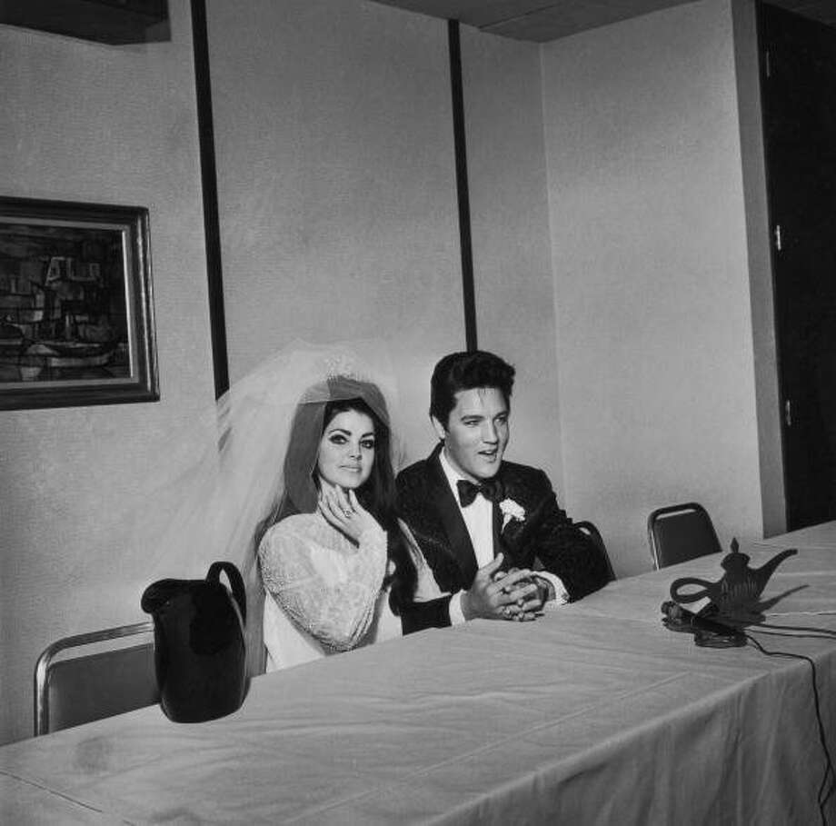 American rock n' roll singer and actor Elvis Presley with his bride Priscilla Presley on their wedding day, at the Aladdin Hotel, Las Vegas, Nevada, 1st May 1967. (Photo by Frank Edwards/Fotos International/Archive Photos/Getty Images) (Getty Images)