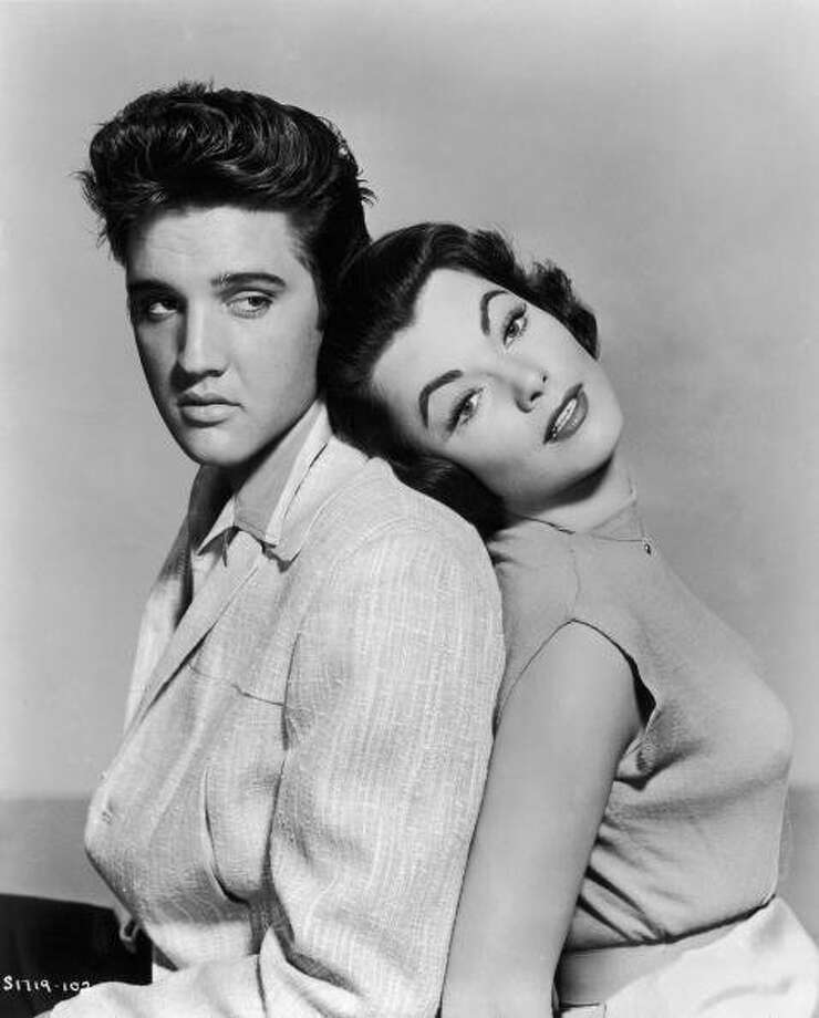 Elvis Presley (1935 - 1977) and Judy Tyler (1933 - 1957) star in the musical film 'Jailhouse Rock', 1957. (Photo by Hulton Archive/Getty Images) (Getty Images)