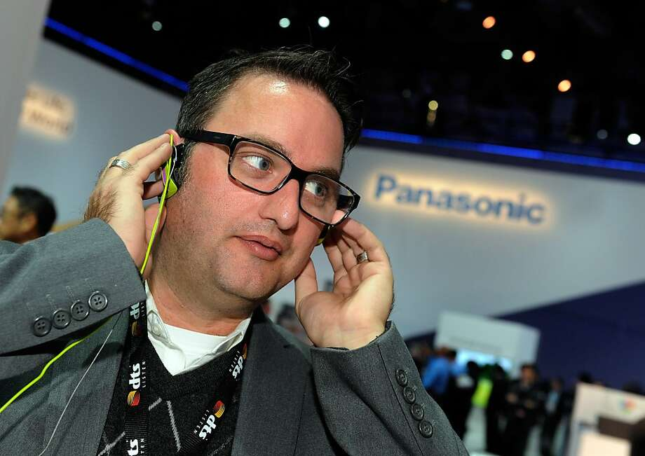 Matt Yaney listens to music using Panasonic's Bone Connection headphones at CES in Las Vegas. Photo: David Becker, Getty Images