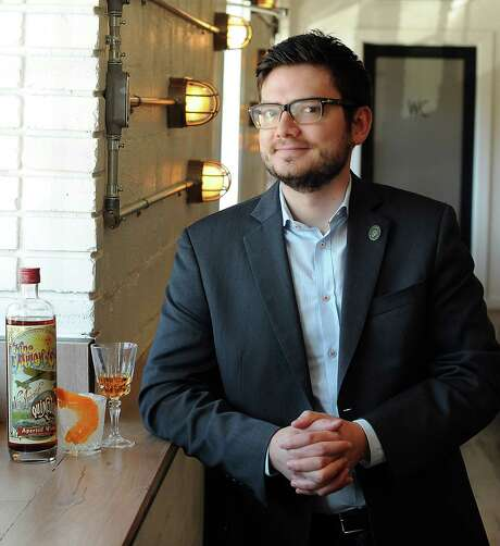 "Travis Hinkle, the sommelier at The Pass & Provisions, with a bottle of Tempus Fugit ""Kina L'Avion D'Or""  Friday Jan 03, 2014.(Dave Rossman photo) Photo: Dave Rossman, Freelance / © 2013 Dave Rossman"