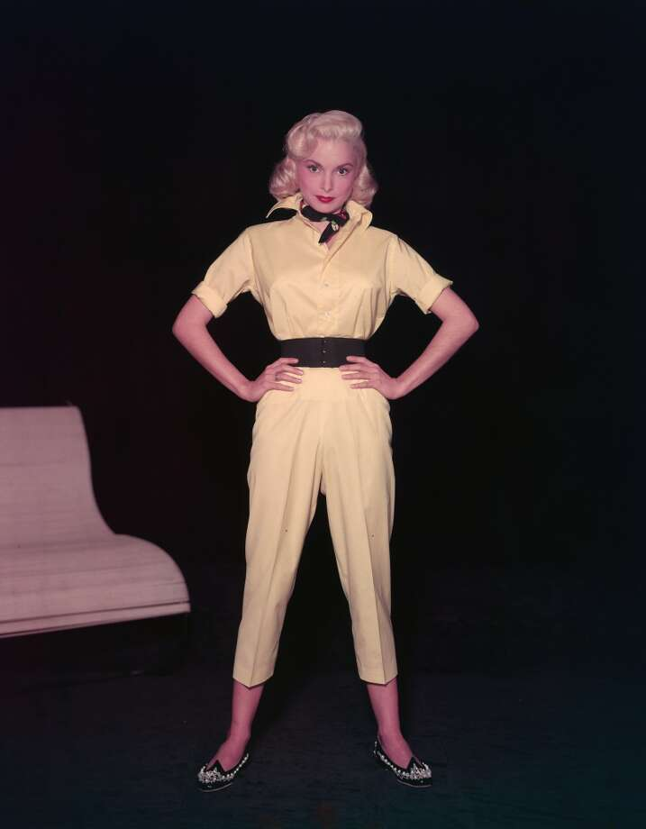 "Janet Leigh (""Psycho"") in a yellow short-legged jumpsuit with a wide belt, beaded shoes, and a neckerchief, 1950s. Photo: Hulton Archive, Getty Images"