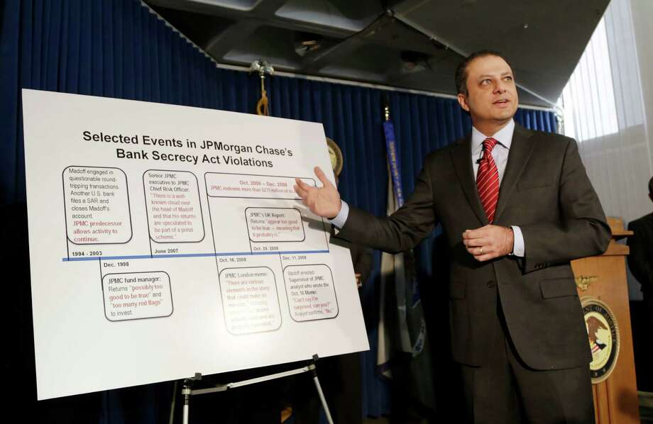 Preet Bharara, U.S. Attorney for the Southern District of New York, announces a settlement with JPMorgan Chase, Tuesday, Jan. 7, 2014 in New York. JPMorgan Chase & Co., already beset by other costly legal woes, has agreed to pay $1.7 billion to settle criminal charges that it ignored obvious warning signs of Bernard Madoff's massive Ponzi scheme, Bharara said Tuesday. (AP Photo/Mark Lennihan) ORG XMIT: NYML107 Photo: Mark Lennihan / AP