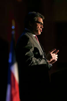 Texas Governor Rick Perry speaks during the Texas Transportation Forum at the Grand Hyatt Regency, Tuesday, Jan. 7, 2014. Photo: Jerry Lara, San Antonio Express-News / ©2013 San Antonio Express-News