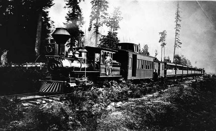 1880: Seattle's first railroad. Pictured above, a locomotive takes a load of passengers to the Georgetown racetrack. Webster & Stevens photo. Photo id 1983.10.6275. To order a reproduction or to inquire about permissions contact photos@mohai.org or phone 206-324-1126.