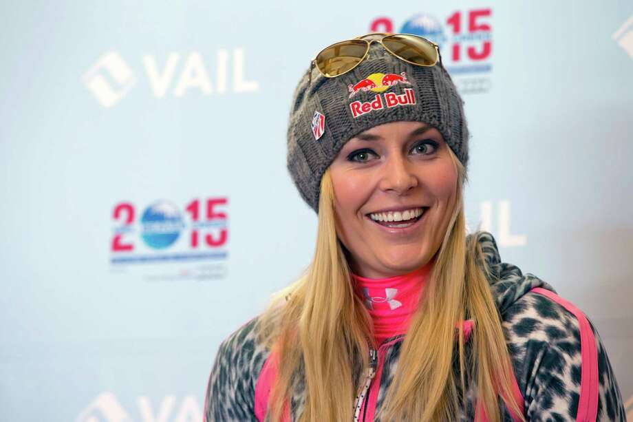 "FILE - In this Nov. 8, 2013 file photo, Lindsey Vonn speaks at a news conference at Gold Peak, Vail, Colo.  Vonn is going to skip the Sochi Olympics because of a right knee injury. Her personal publicist, Lewis Kay, says in a statement Tuesday, Jan. 7, 2014,  that Vonn ""will have surgery shortly."" The 29-year-old American won two medals at the 2010 Vancouver Olympics, including a gold in the downhill. She is also a four-time overall World Cup champion and the biggest name in Alpine skiing.  (AP Photo/Nathan Bilow) ORG XMIT: NY110 Photo: Nathan Bilow / FR37383 AP"