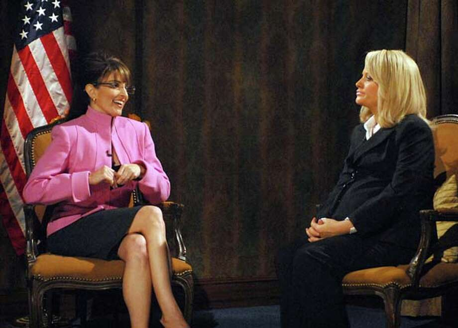 Tina Fey as former Governor Sarah Palin, Amy Poehler as Katie Couric during the 'CBS Evening News' skit on September 27, 2008 Photo: NBC, NBC Via Getty Images / 2012 NBCUniversal, Inc.