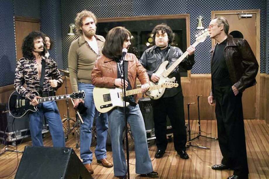 "Chris Kattan as Buck Dharma, Will Ferrell as Gene Frenkle, Chris Parnell as Eric Bloom, Horatio Sanz as Danny Miranda, Christopher Walken as Bruce Dickinson during ""Behind the Music"" skit on April 8, 2000 Photo: NBC, NBCU Photo Bank Via Getty Images / 2012 NBCUniversal Media, LLC."