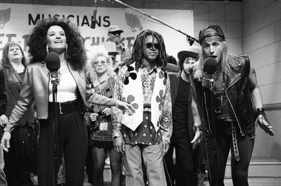Jan Hooks as Diana Ross, Tim Meadows as Lenny Kravitz, Adam Sandler as Axl Rose during the 'Musicians For Free-Range Chickens' skit on April 20, 1991 Photo: NBC, NBC Via Getty Images / © NBC Universal, Inc.