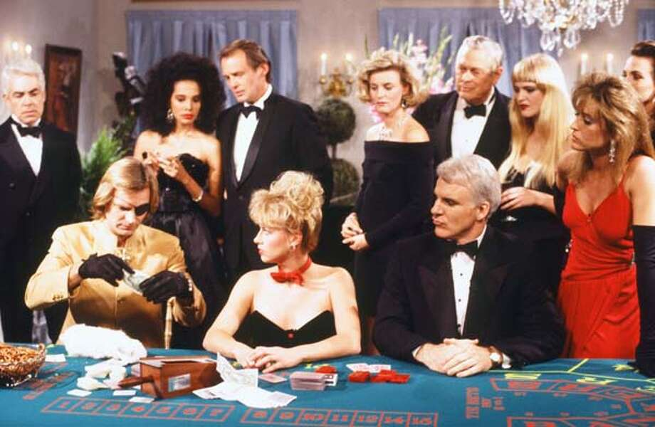 Sting as Goldstring, Victoria Jackson, Steve Martin as James Bond, and Jan Hooks as the date during the 'Bullets Aren't Cheap' skit on October 17, 1987 Photo: NBC, NBC Via Getty Images / © NBC Universal, Inc.