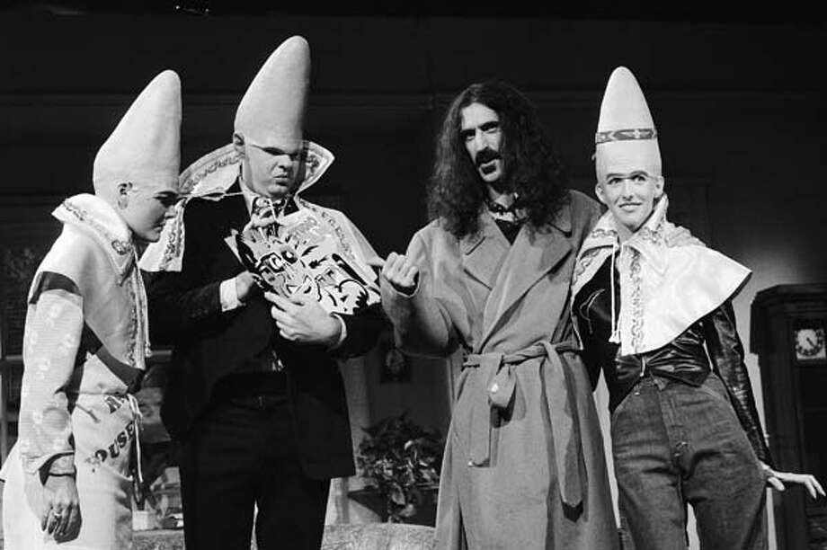 Jane Curtin as Prymaat Conehead, Dan Aykroyd as Beldar Conehead, Frank Zappa, Laraine Newman as Connie Conehead during 'The Coneheads at Home' skit on October 21, 1978 Photo: NBC, NBC Via Getty Images / © NBCUniversal, Inc.