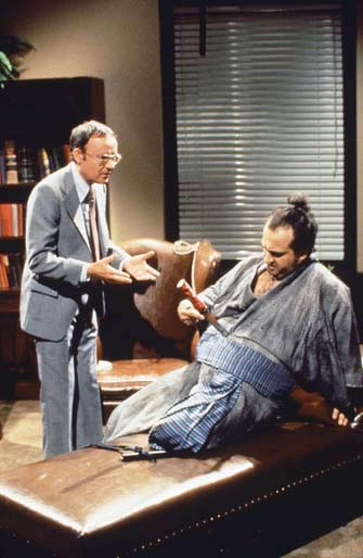 Buck Henry as Mr. Dantly, John Belushi as Samurai Futaba during 'Samurai Psychiatrist' skit on November 19, 1977