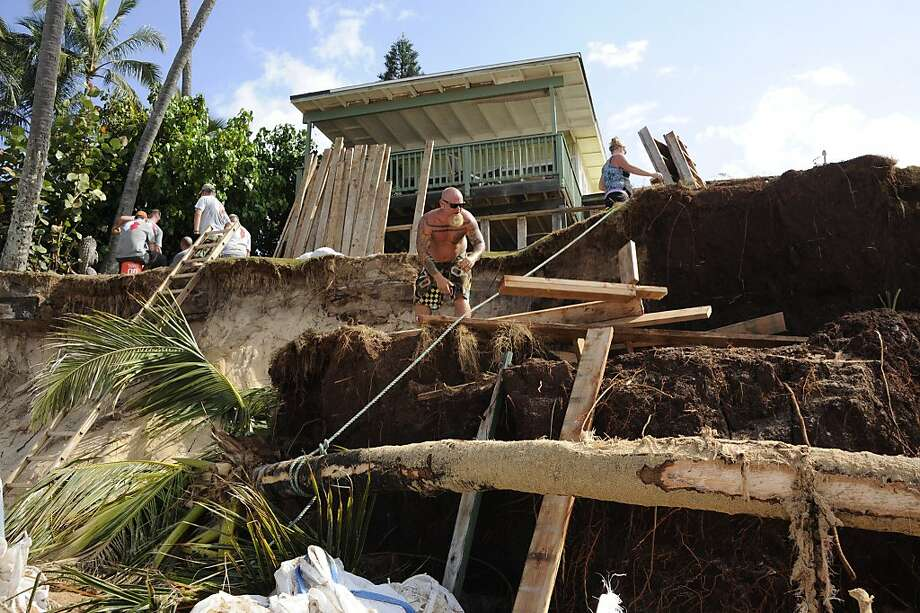 Ke Nui Road property owner Kenneth Dombrowski does whatever he can to shore up the hillside to prevent erosion. Surf has affected coastal homes this winter despite there being relatively few giant swells along the North Shore. Photo: Craig Kojima, Honolulu Star-Advertiser