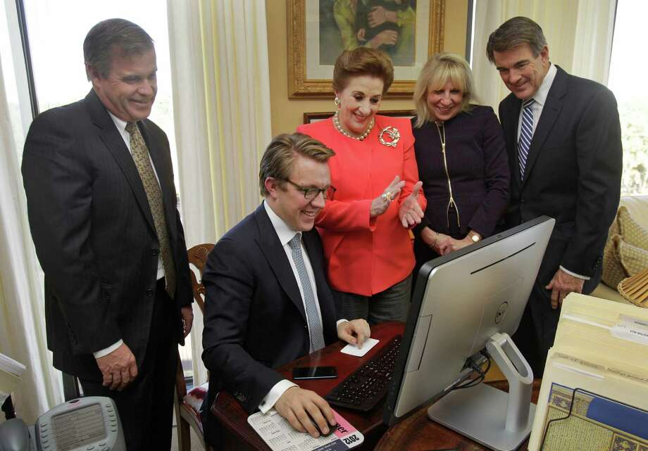 Watching a new advertising video Tuesday in the Martha Turner Properties offices are, from left, Bruce Zipf, of NRT LLC; Bradley Nelson, of Sotheby's International Realty;  Martha Turner, co-president of Martha Turner Sotheby's International Realty; Kathryn Korte, of Sotheby's International Realty; and Tom Anderson, co-president of Martha Turner Sotheby's International Realty. Photo: Melissa Phillip, Staff / © 2014  Houston Chronicle